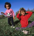 picture of girl playing in grass; link for environmental article, Chemical Pesticide Exposure and Effects on Children