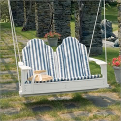 picture of wooden bench swing over grass with embedded stone pavers