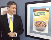 funny natural foods video link; thumb of spokesman pointing to natural sign