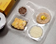 funny school lunch video link; thumb of upscale children's food in sectioned plastic container