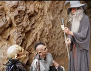 funny Gandalf video link; thumb of Gandalf showing card trick to two orcs