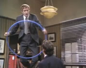 funny flying video link; thumb of man standing on desk with a hoop