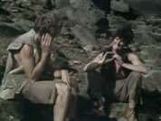 pic of two hermits talking on rocky hill; link for funny animation/video; opens in new window