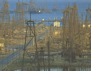 music videos about oil link; thumb of oil derricks on shore
