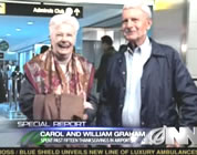 funny thanksgiving travel video link; thumb of happy older couple at airport