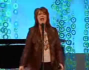 photo of woman on stage singing; link for funny animation/video; opens in new window