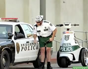 funny environmental ads link; thumb of green cop pulling over a regular cop