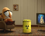 nuclear waste solutions videos link; thumb of man sitting in livingroom with TV and a drum of nuclear waste