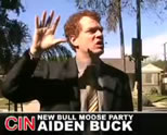 politician speaking on campaign trail; caption reads, Aiden Buck, The New Bull Moose Party; click to see video on YouTube