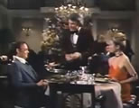 waiter and two diners; click to go to video page